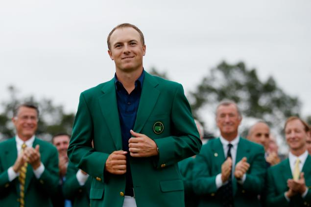Jordan Spieth poses with the Kelly green jacket after winning the 2015 Masters Tournament at Augusta National