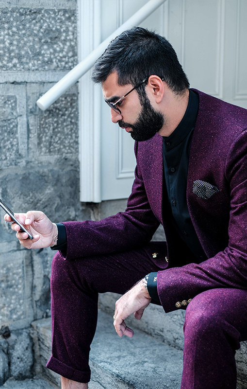 Surmesur_naeem_adam_burgundy_suit_cellphone